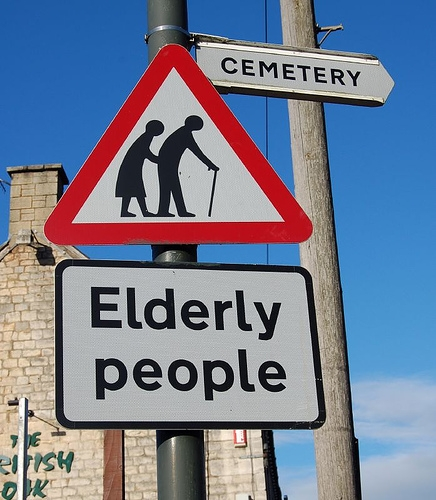 funny-road-sign-elderly-cemetery